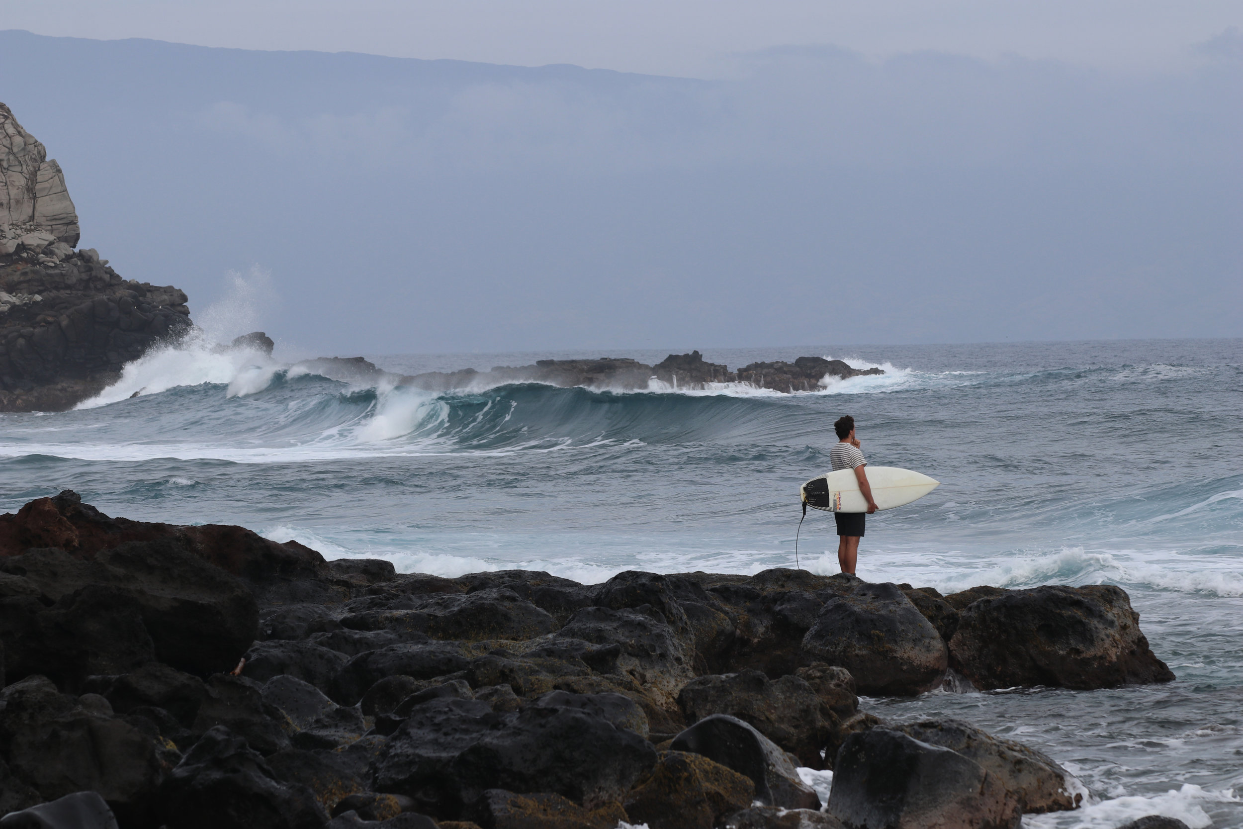 You had to time this paddle out pretty well...if you left when there was a cleanup set, chances were you'd end up back on the rocks. You couldn't duck dive right off the bat because the water was only about 1' deep over sharp reef.