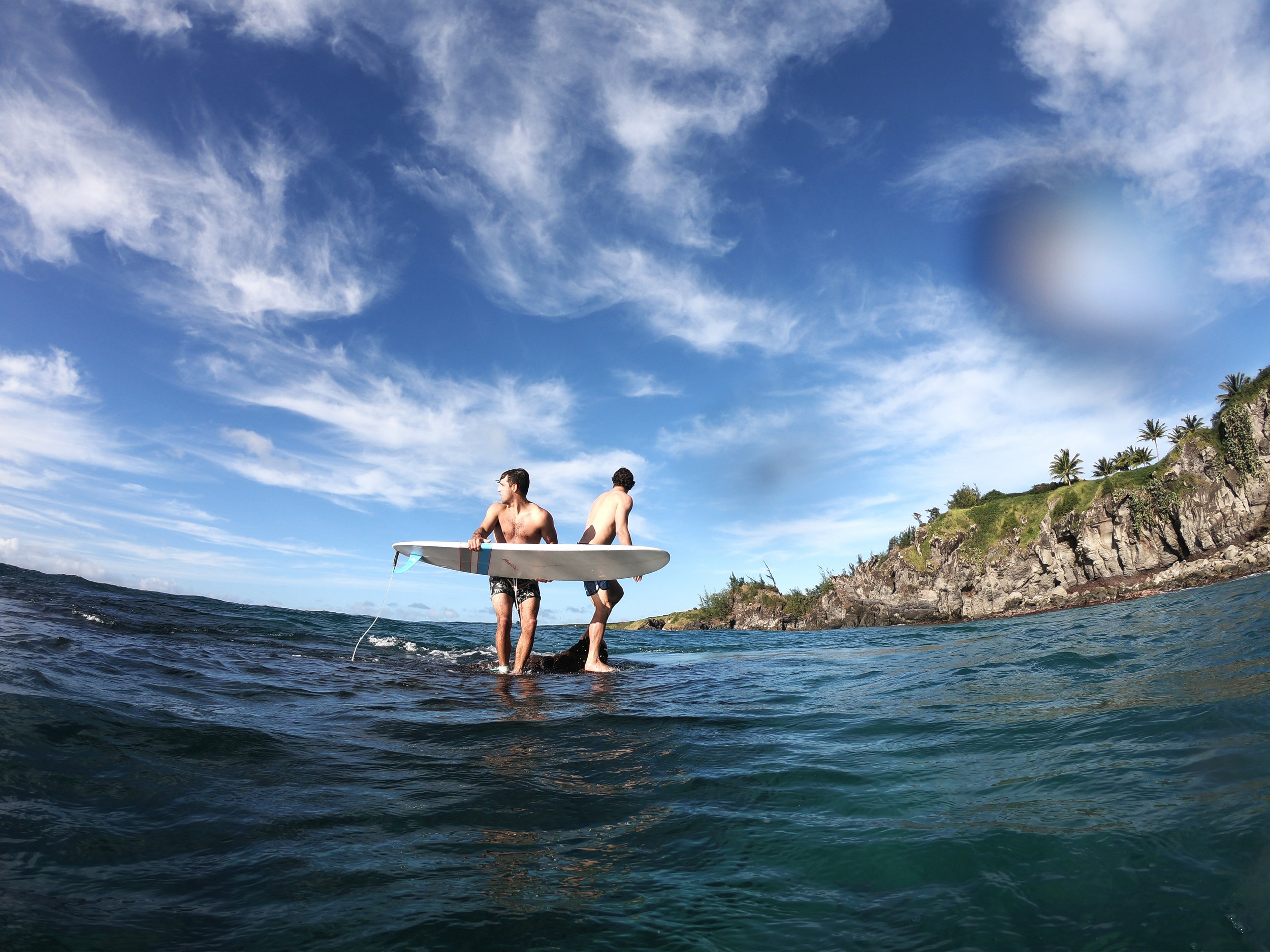 We spent all our afternoons in-between sessions snorkeling and jumping off this rock into waves.