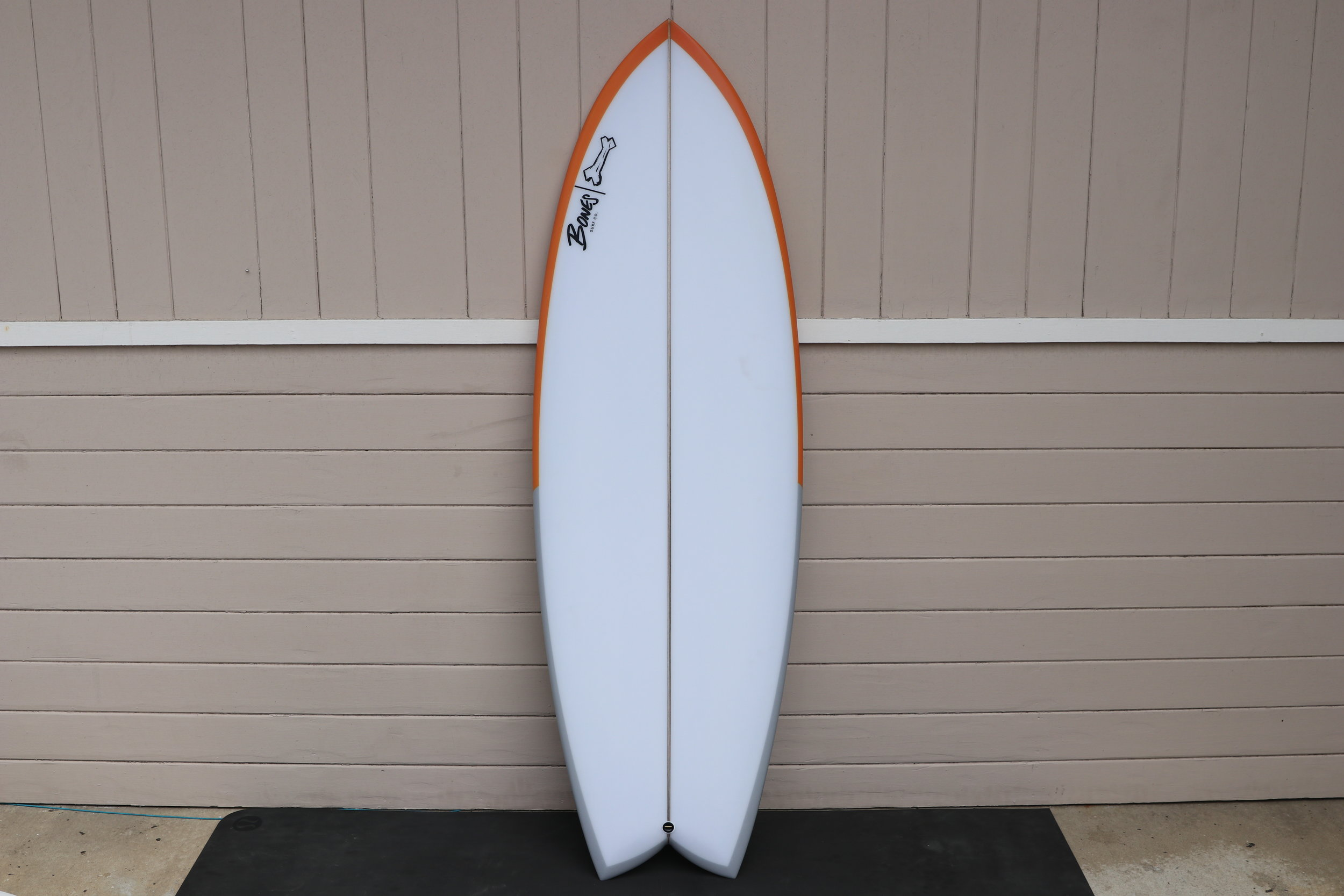 "Fish Taco  5'6 x 21.5 x 2.55  This Fish Taco is slightly modified from my go to model. The swallow tail is 3.25"" deep vs my normal 4.75"" and the wide point is pushed up about 1"". I also toed in the fin boxes at 1/4"" vs my normal 1/8"". We were thinking that we wanted to try and make the board a bit more maneuverable while sacrificing some drive. I usually recommend K1 or K2 keel fins for Tacos, but this one is strictly for Mark Richards style twinnies. I imagine Jazz riding this board when the waves are a bit smaller, or a nice long soft point break. I am excited to hear how it works on all those right points on the Gold Coast."