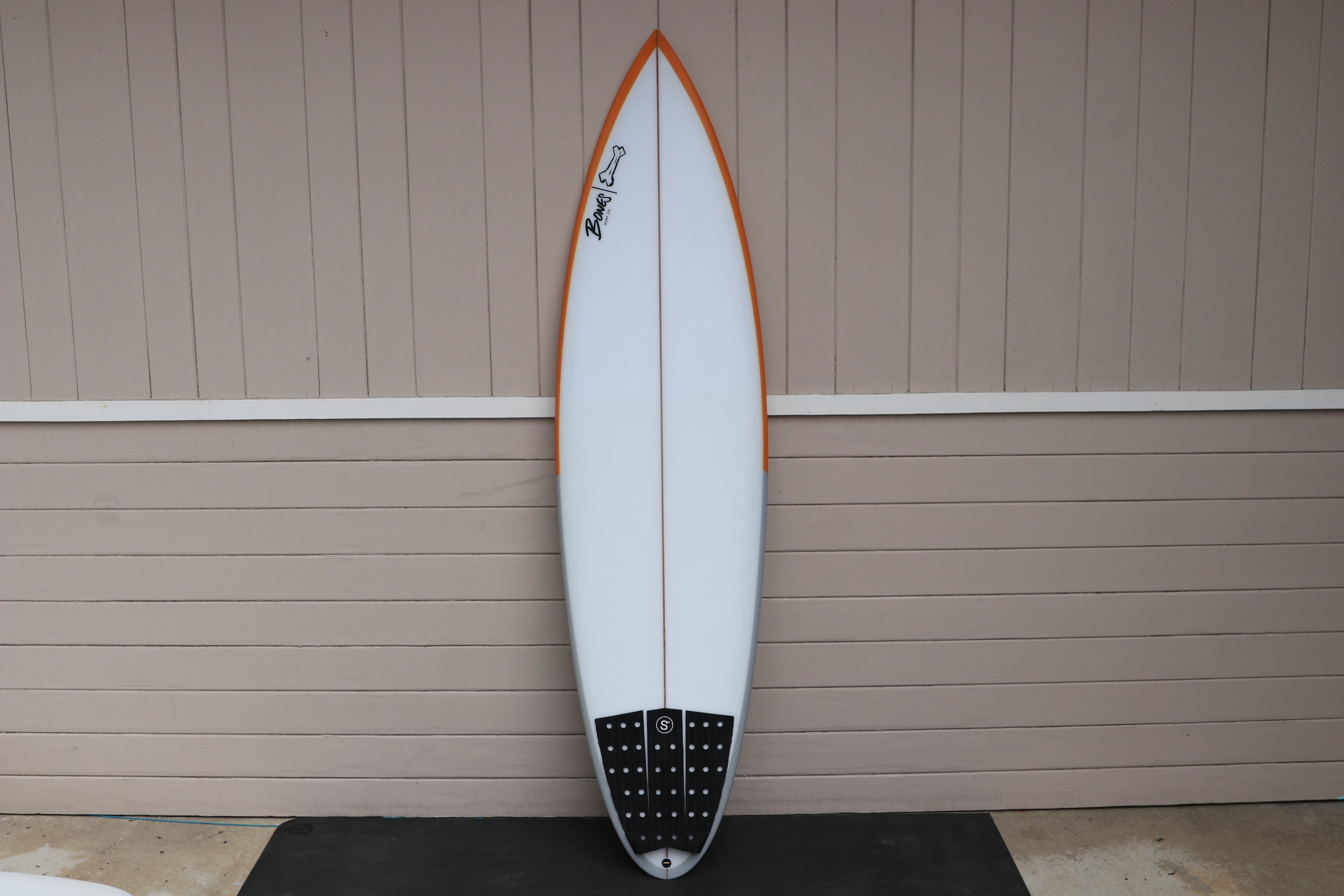 Beer Chug  6'6 x 19.75 x 2.65  This is the first Beer Chug I have made. There has been a lot of research and thought put behind this model. The wide point is further up and there is a good deal of foam in the front of the board for paddle power. The tail has a bit more width than your traditional step up pin tail. I wanted it to be good in the barrel, hold and be predictable. But I also wanted it to work well in big point breaks that might be more wave face with more carves and cut backs than barrel shooting. I put 5 fin boxes in back. This board is glassed heavy, has denser foam, and is definitely for big waves. I recon Jazz will surf this in well overhead barrels up to triple overhead point breaks. If anything is going to get him into trouble on this trip, it is this board.