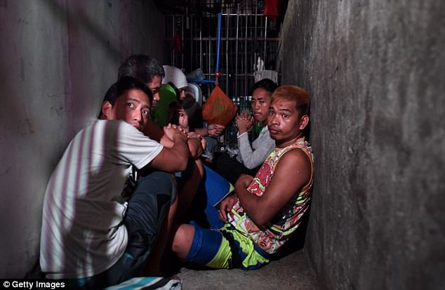 Inhumane conditions - People crammed in a cell the size of a twin mattress with a broken toilet.