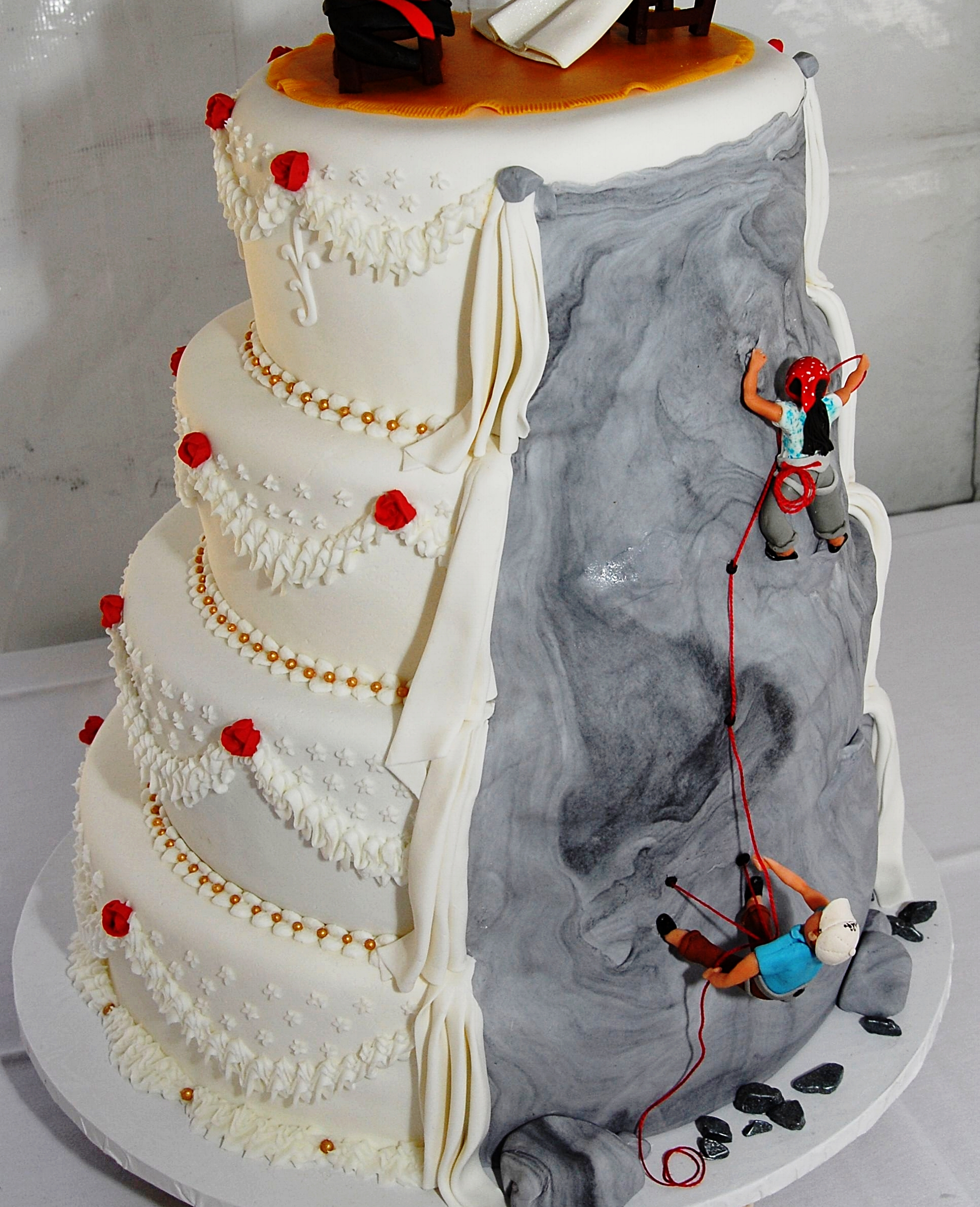 Cake Image from  Cake Central  and it's a wedding cake not a birthday cake.There is a whole  Pinterest  page of climbing themed cakes - two of our favorite things.