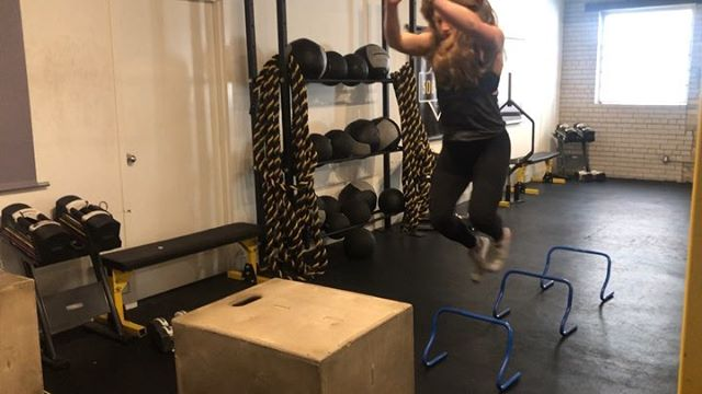 "@sylvietetrault and I thought we'd dive right into this week's #workwoutwednesday by introducing day 2 of our current strength programming . . In the first video we super set HURDLE JUMPS and MONSTER WALKS. You'll notice we start off most of our strength days with a an activation superset. Here, both aim to prep us for our Front Squats. . . In Video two we superset our FRONT SQUATS with a LAT-TRI INSERTION STRETCH that doubles as a nice T-Spine opener. The hardest part of a front squat for most people is maintaining the rack positive and this active stretch targets exactly that. Pull outwards on the dowel as you sink the chest down. Keep your core engaged so a flaring ribcage doesn't rob you of the stretch. On your front squats themselves, think ""up and in"" with the elbows as you drive up from the bottom. . . Video Three, CHIN UPS AND WEIGHTED PUSH UPS. The Chin ups as programmed had us doing one and a half reps but truth be told - we just didn't have it in us! Instead, we respected our bodies' wishes and kept it simple. Four sets of four with a slow motion eccentric on the last rep. Also @championshiplifestyle, weighted push ups are hard... . Last but not least, came SA FRONT RACK CARRIES and LATERAL SLED DRAGS. Because it wasn't the right weather for @fueltrainingclub's outdoor prowler, we subbed in Reverse Crossback Lunges with the landmine for a similar effect. Just enough reps at just heavy enough weight to get that heart rate up and those glutes on 🔥. . Happy Training Friends . Video five, training is always better with a furbaby on sight 🐶❤️ . . #GNstrengthseries #stronggirls #squat #pullup #pushup #kettlebells"
