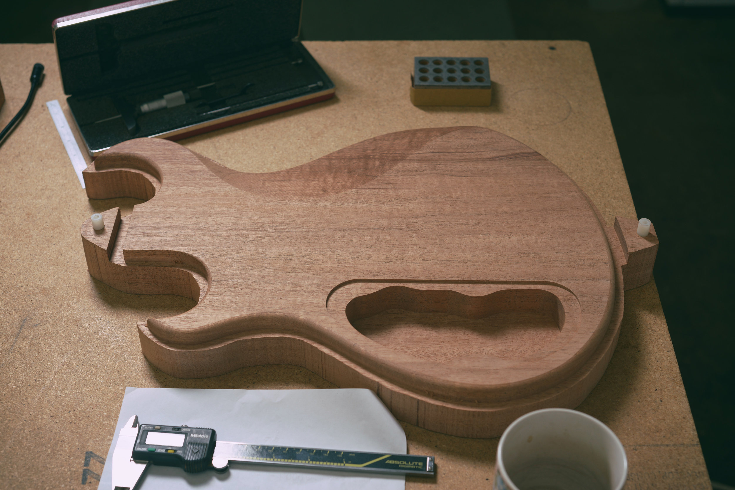 Inspecting body back prior to cutting the body top carve.