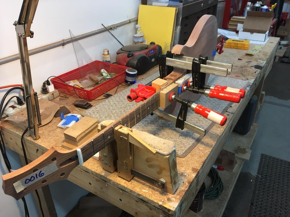 Gluing neck assembly to the body.