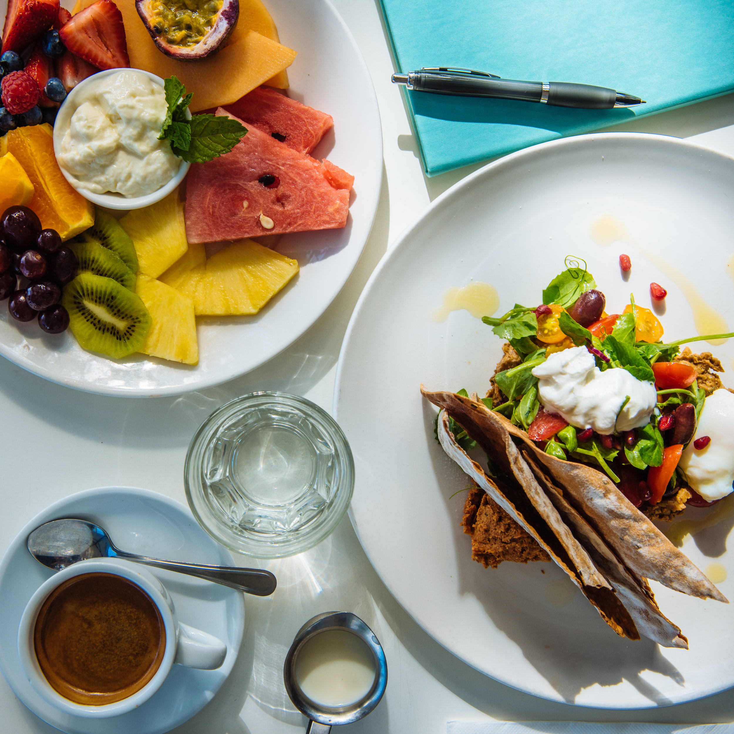 On the right Bistro C's 'Yaddah's Breakfast' with walnut & pomegranate hummus, olives, goats curd, muhammara, heritage tomatoes etc, etc. On the left, a delicious plate of seasonal fruits with honey-yogurt topped off with a long black and a dash of milk on the side. Just how I like it.