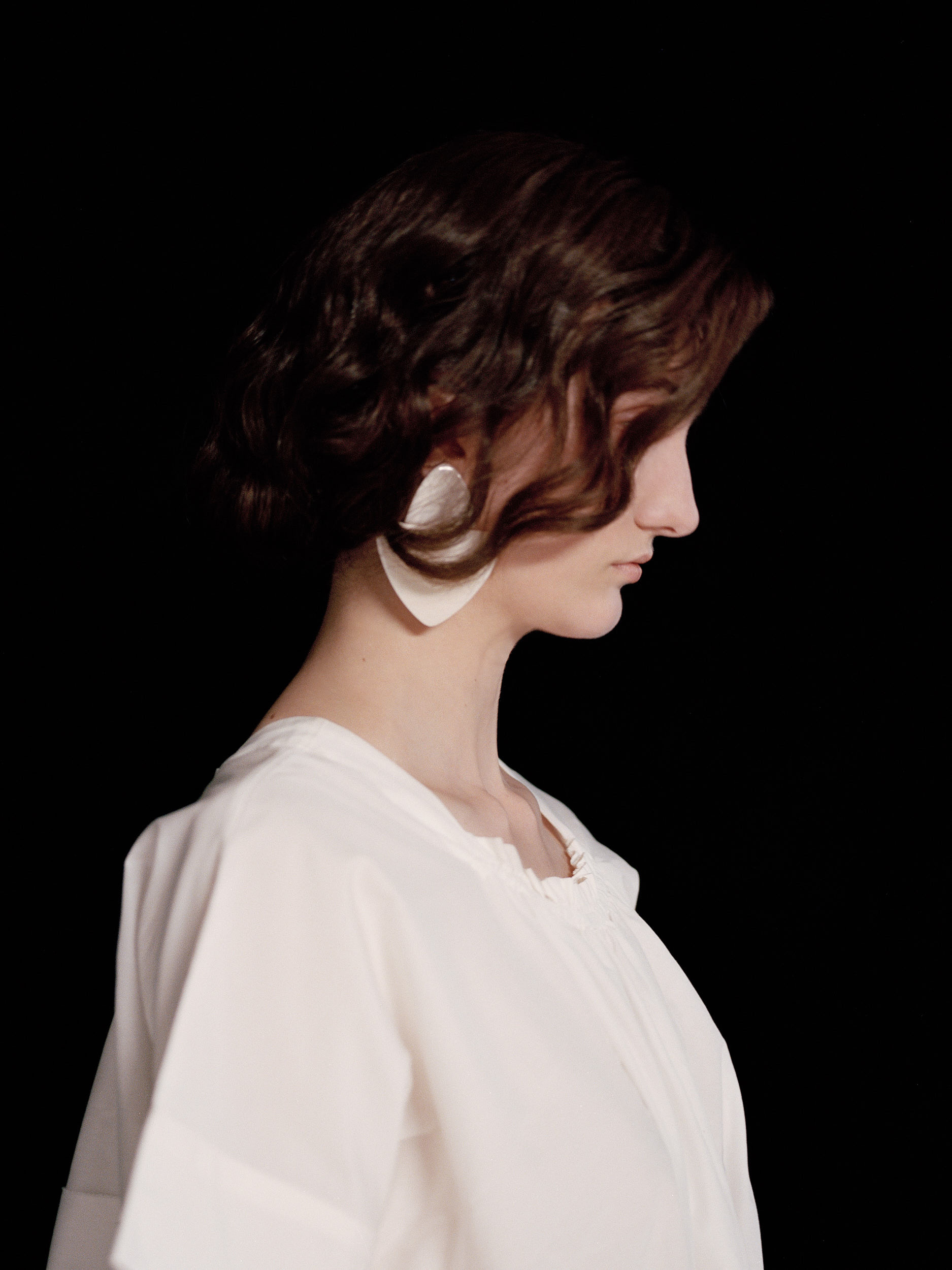 White Ruffled Dress by Renli Su, Ivory Bone Earrings by Monies