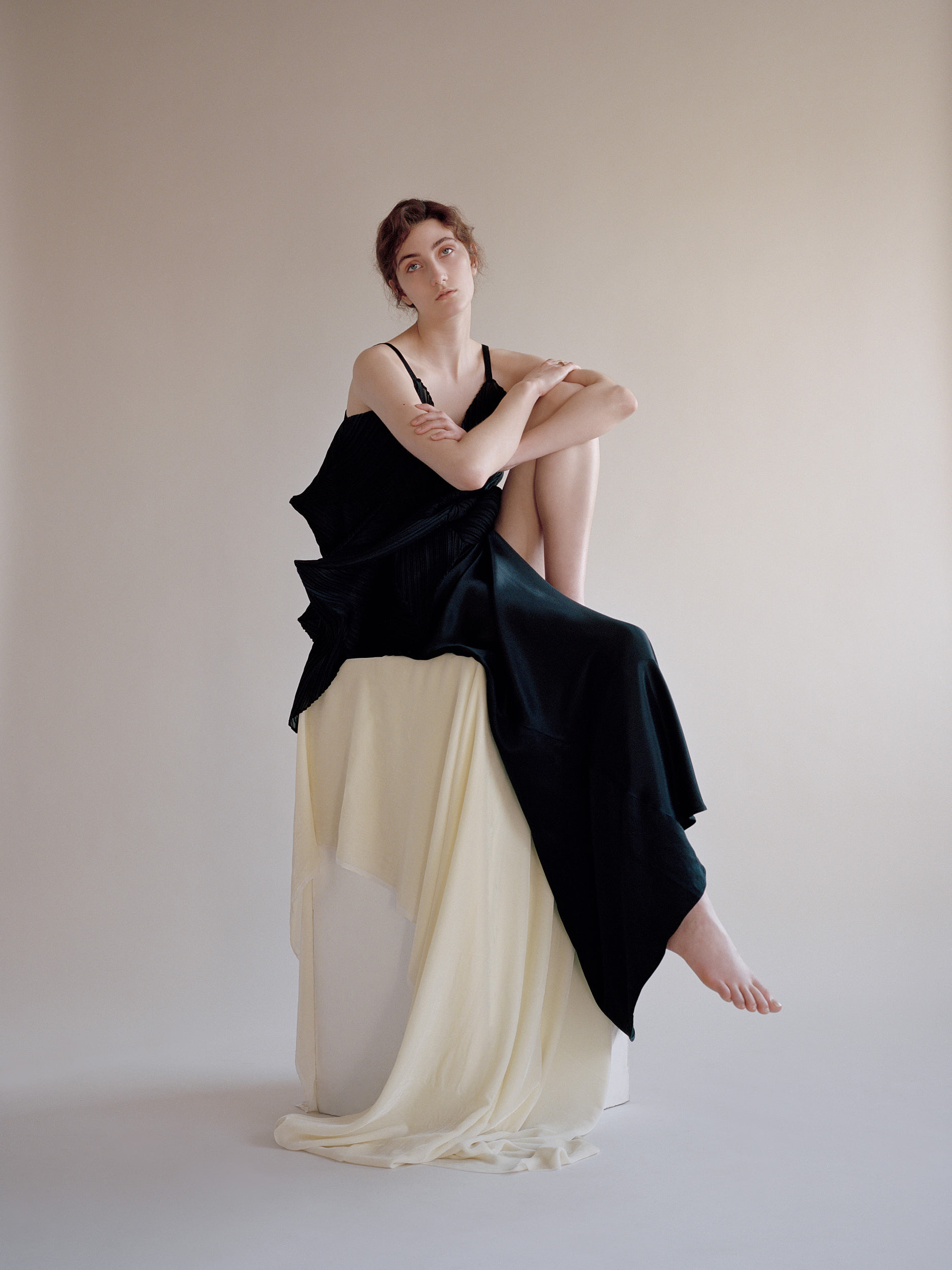 Black Pleated Dress by Issey Miyake, Gold and Diamond Ring by Completed Works