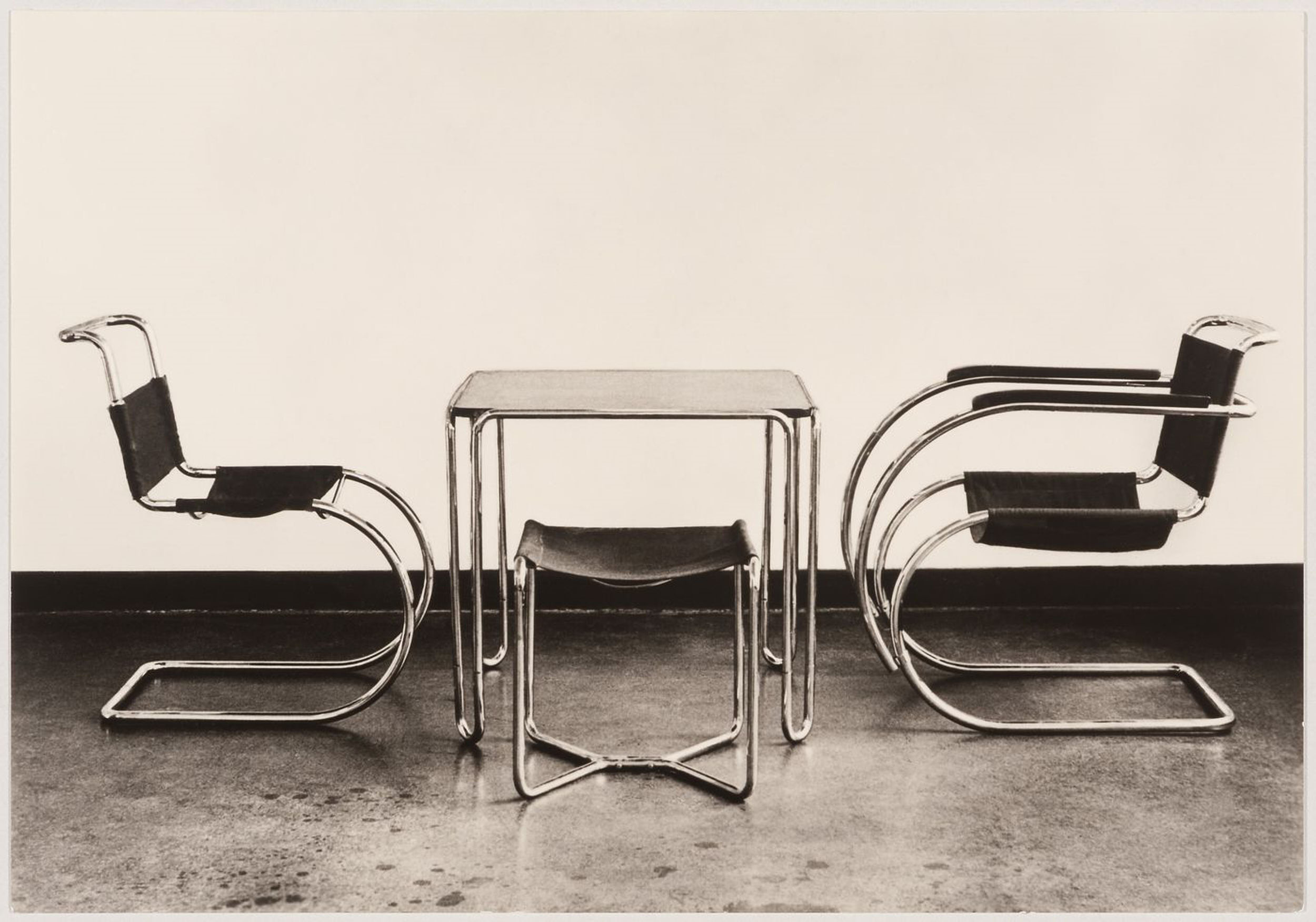Interior view of the Bauhaus building showing two chairs designed by Mies van der Rohe and a table and stool designed by Marcel Breuer, Dessau, Germany — Collection Centre Canadien d'Architecture/ Canadian Centre for Architecture, Montréal