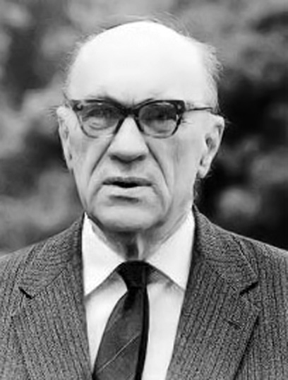 Black and white photo of Jarosław Iwaszkiewicz, an older white Polish man with thick glasses and very little white hair. He has a puzzled expression. He is wearing a suit.