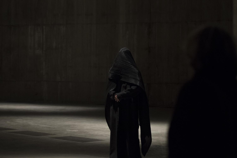Tuck Muntarbhorn performing 'Walking in Silence' in The Tanks at Tate Modern