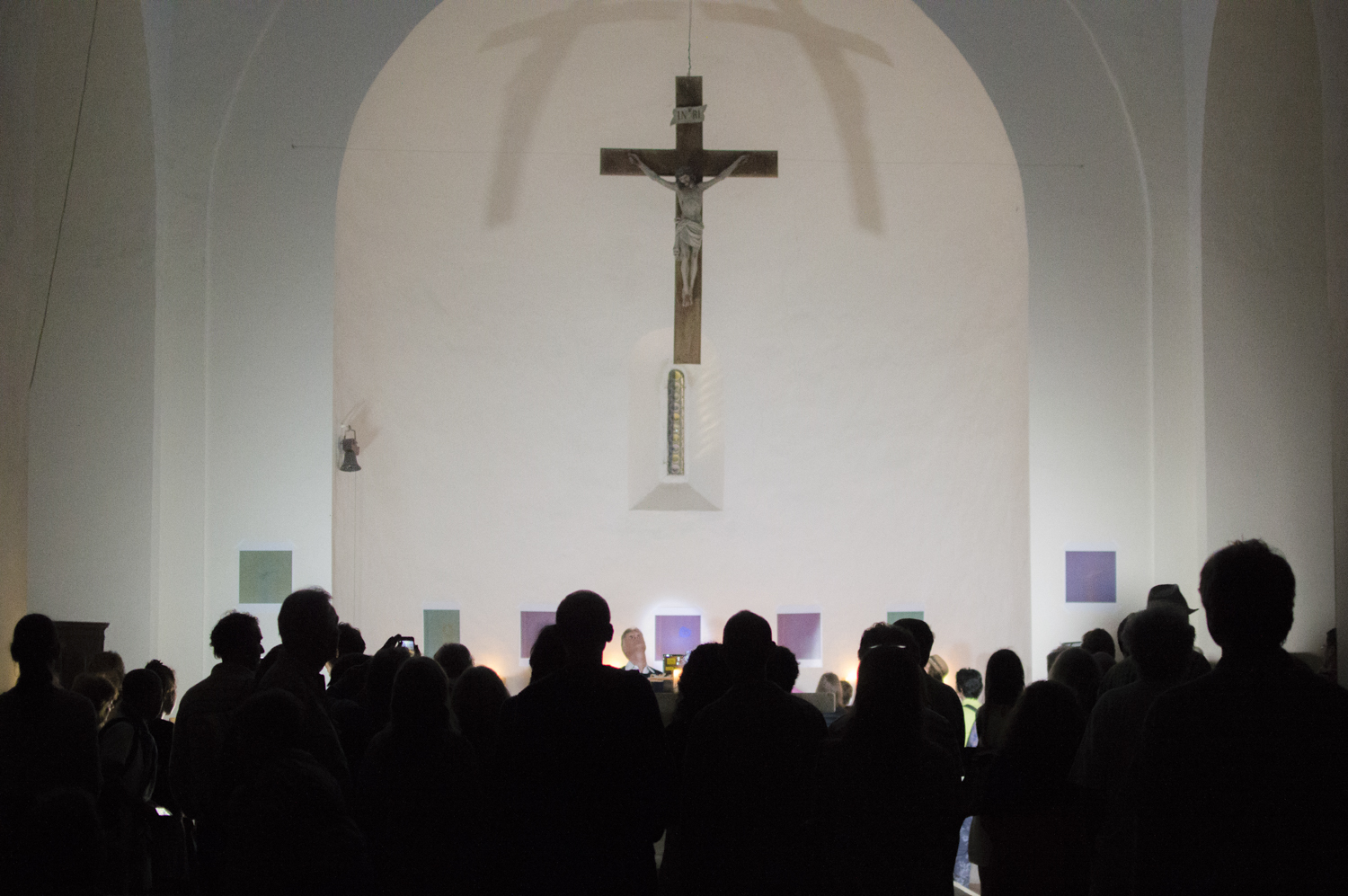 Audiences gather at the altar in  Communion II , Tuck Muntarbhorn's first solo exhibition in Sarteano (Tuscany), 2017