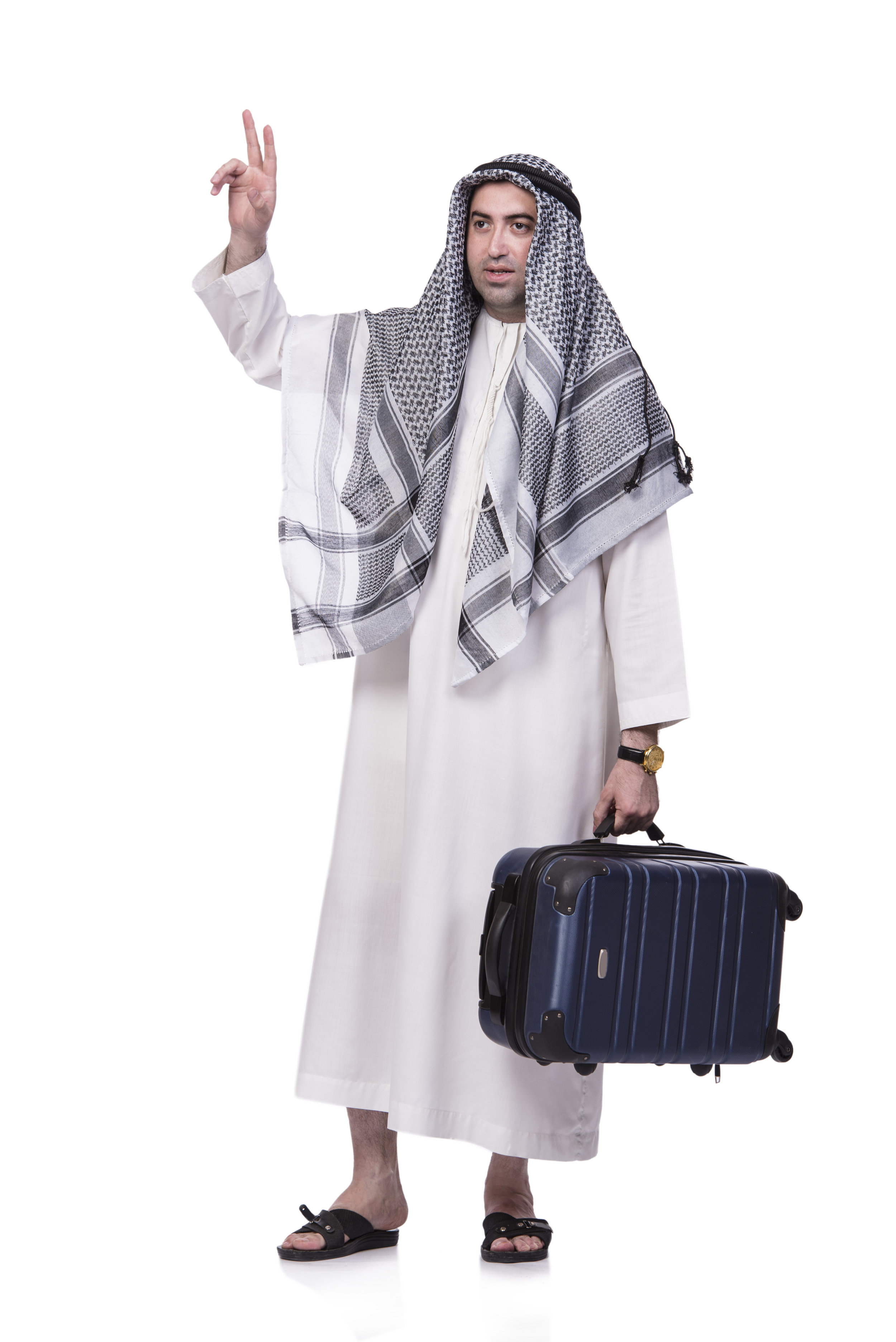 bigstock-Arab-man-with-suitcase-in-trav-138774068.jpg
