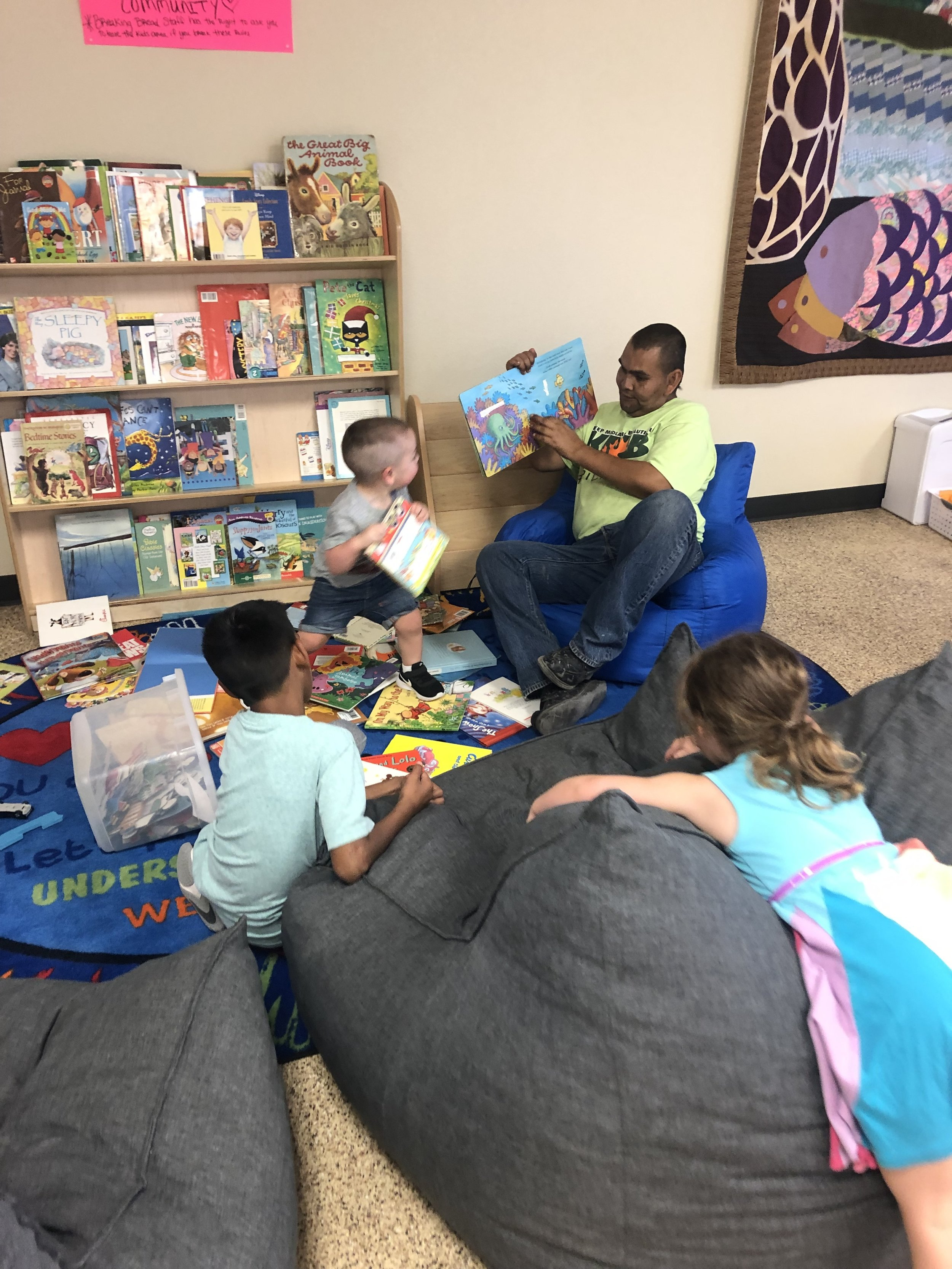 Robert reading to the kids at Breaking Bread