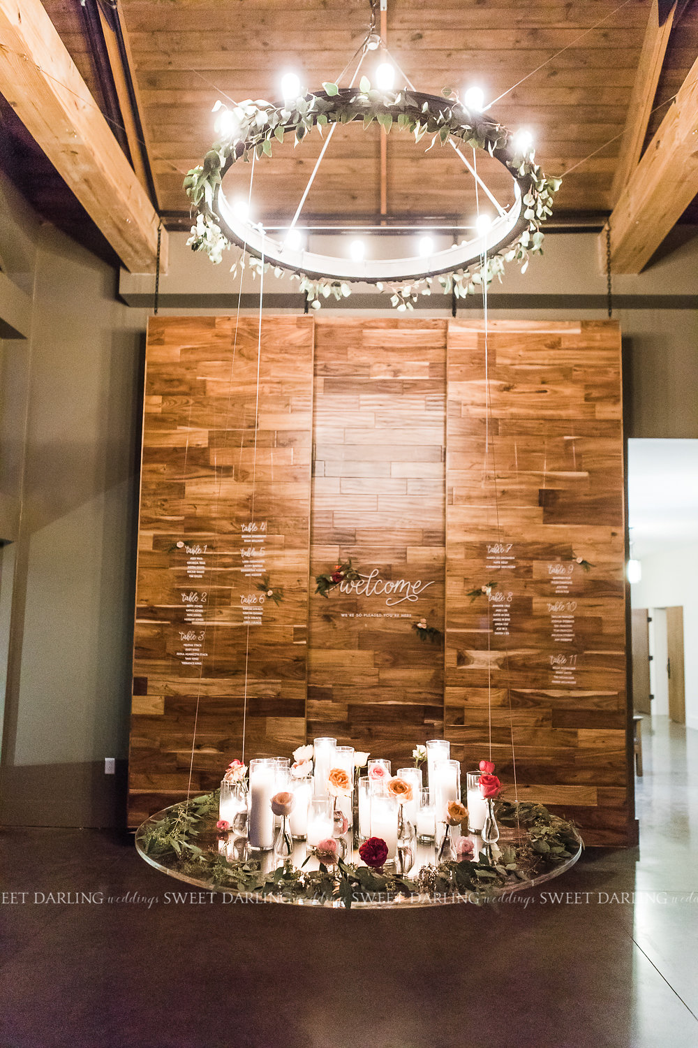 This amazing, suspended acrylic table welcomed guests.  Hung from the high beams of the foyer, a beautiful gathering of candles, single stem bud vases, and seeded eucalyptus set off a welcoming glow. The amazing hand lettering of Emily at  Dash/wood  was featured on the acrylic welcome and seating chart.