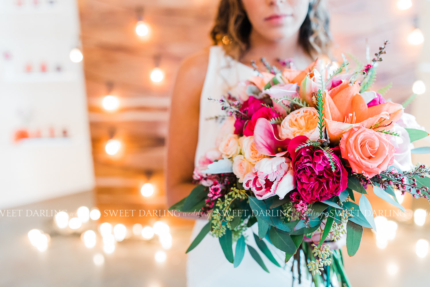 One of my all time favorite bouquets, this stunner included several varieties of garden roses, standard roses, coral amaryllis, light pink parrot tulips, calla lilies and mixed foliage and fillers.