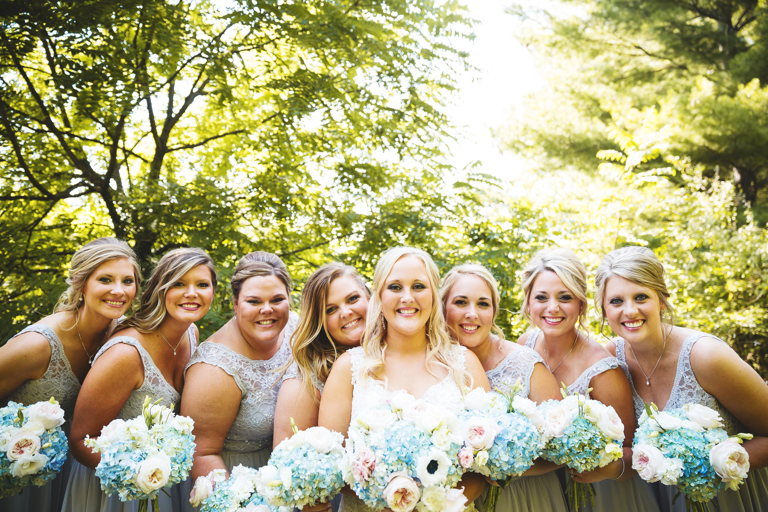 Jackie chose blue hydrangea, blush garden roses, panda anemone, white lisianthus and stock with no greenery for both her bridal bouquet and the bridesmaids.