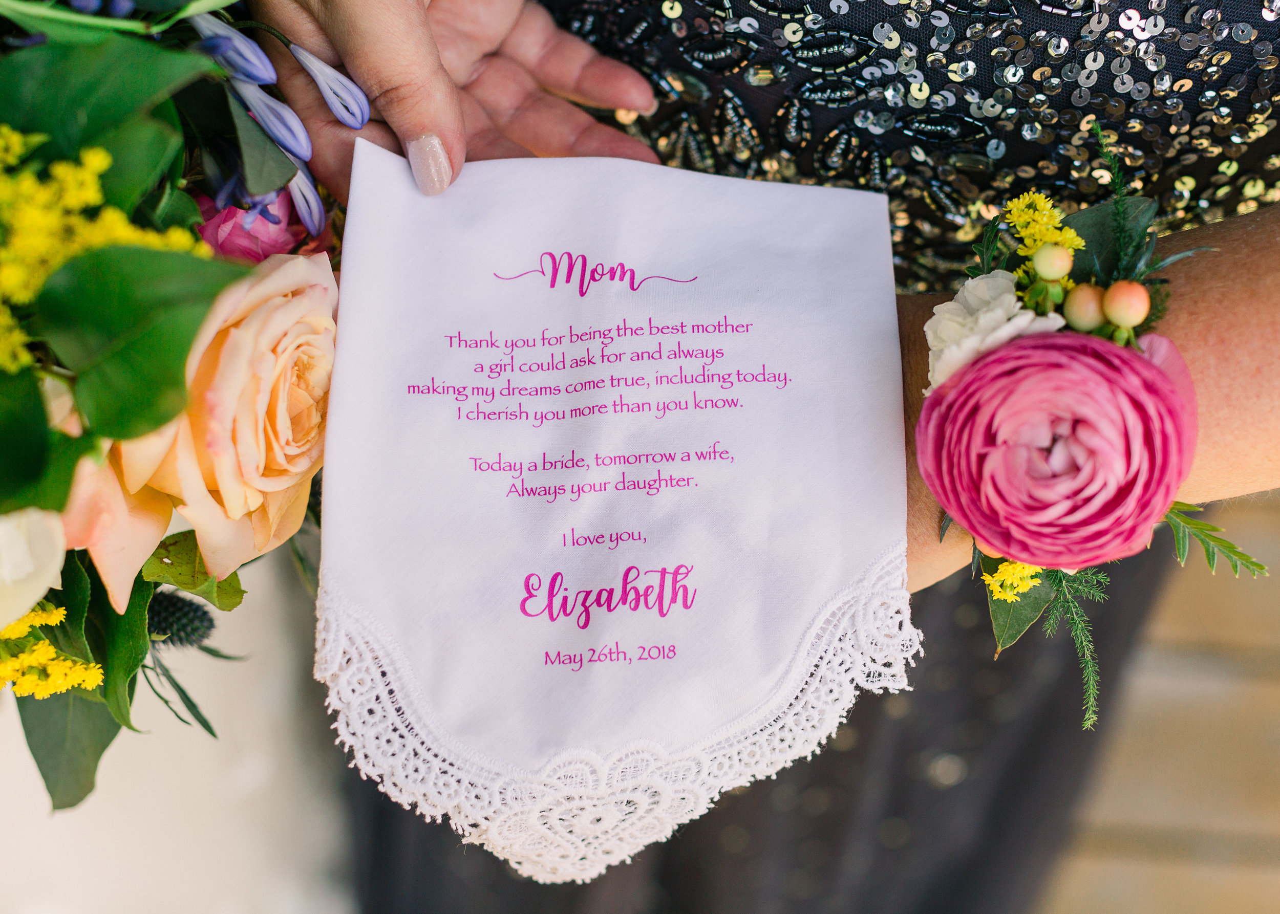 The bridesmaids carried bouquets of Shimmer roses, white stock and hypericum berry.  The mothers corsages were pink ranunculus and textural filler on gold cuff bracelets.