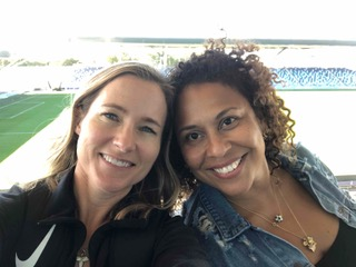 Kely and I at the Manchester City women's stadium, a footbridge connects to the men's stadium.
