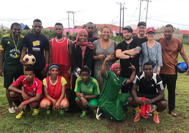 Filming in Zanzibar with our team, Kely (Co-director), Justin Noto (Co-director) and Eric Branco (Director of Photography), pictured with Fatma a local activist and a group of local football players men and women.