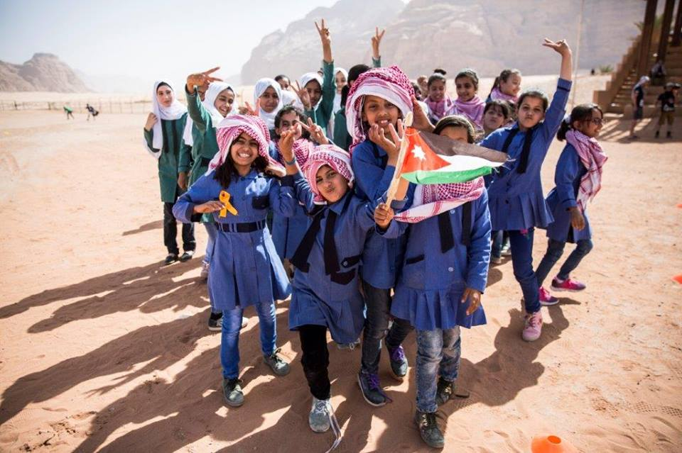 Girls with flag, Wadi Rum football clinic.jpg