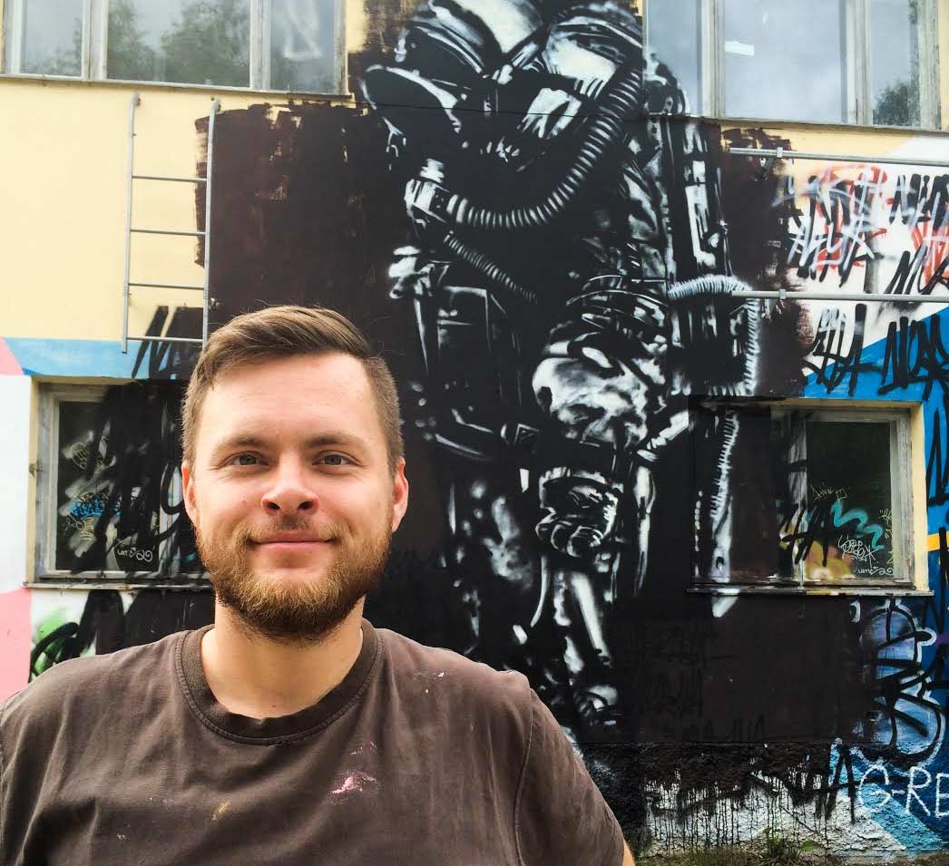 Jesse Pasanen   Jesse is known for being a founding member of Street Art Vantaa and  Grafia's   G-Rex . Pasanen has been involved in lots of various projects ranging from  Multicoloured Dreams  -co-operations to all sorts of  freelance work.  If you're interested in  City of Vantaa's Art Museum Artsi's  mural plans and other street art stuff around Myyrmäki and Vantaa please contact Jesse!   Aalto-yliopistosta ponnistava graafinen suunnittelija ei yleensä toimistoissa homehdu. Värikkään matkan varrella Jesse Pasanen on ollut mukana Street Art Vantaan ja    Grafia ry   :n katutaidekilta    G-Rexin    perustamisessa sekä    Multicoloured Dreamsin    projekteissa. Taiteilijalla on suora ja       seinähullu yhteys    Vantaan taidemuseo Artsiin   . Oma tyyli ikuisesti hakusessa, mutta tärkeämpää on saada näpit maaliin.     Portfolio:   g-rex.fi/jessepasanen   Contact / Ota yhteyttä:  jesse(at)jessepasanen.com