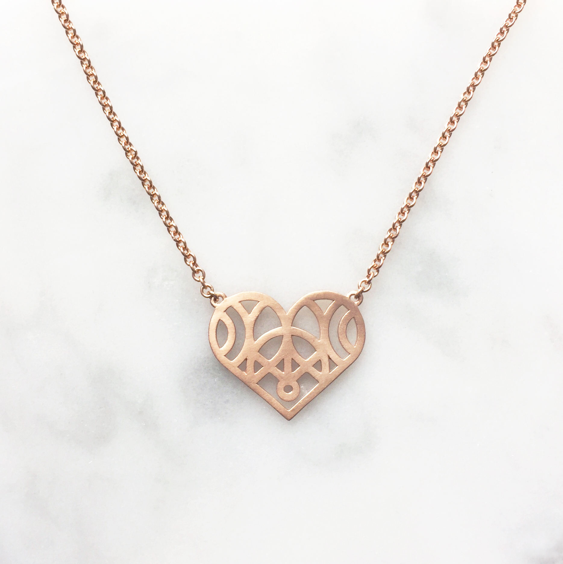 18ct rose gold heart pendant, using gold from customers inherited wedding band.