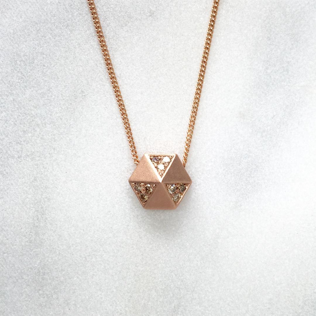 18ct rose gold hex pendant set with cinnamon diamonds.
