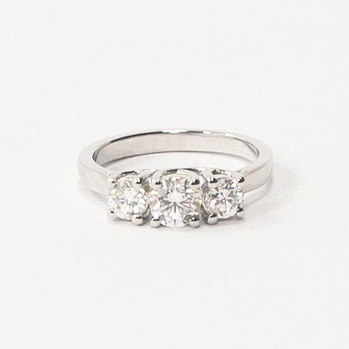 Platinum three stone trilogy ring, set with white diamonds totalling to 1.5 carats.