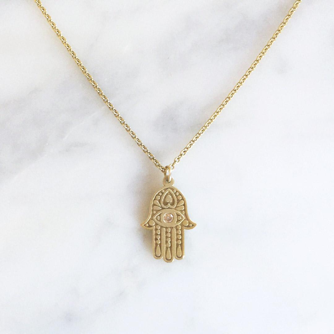 18ct yellow gold Hamsa Hand pendant set with cinnamon diamond.