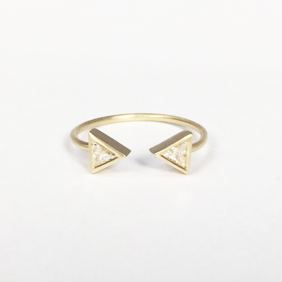 9ct yellow gold open arrow ring, set with two trillion shaped white diamonds.