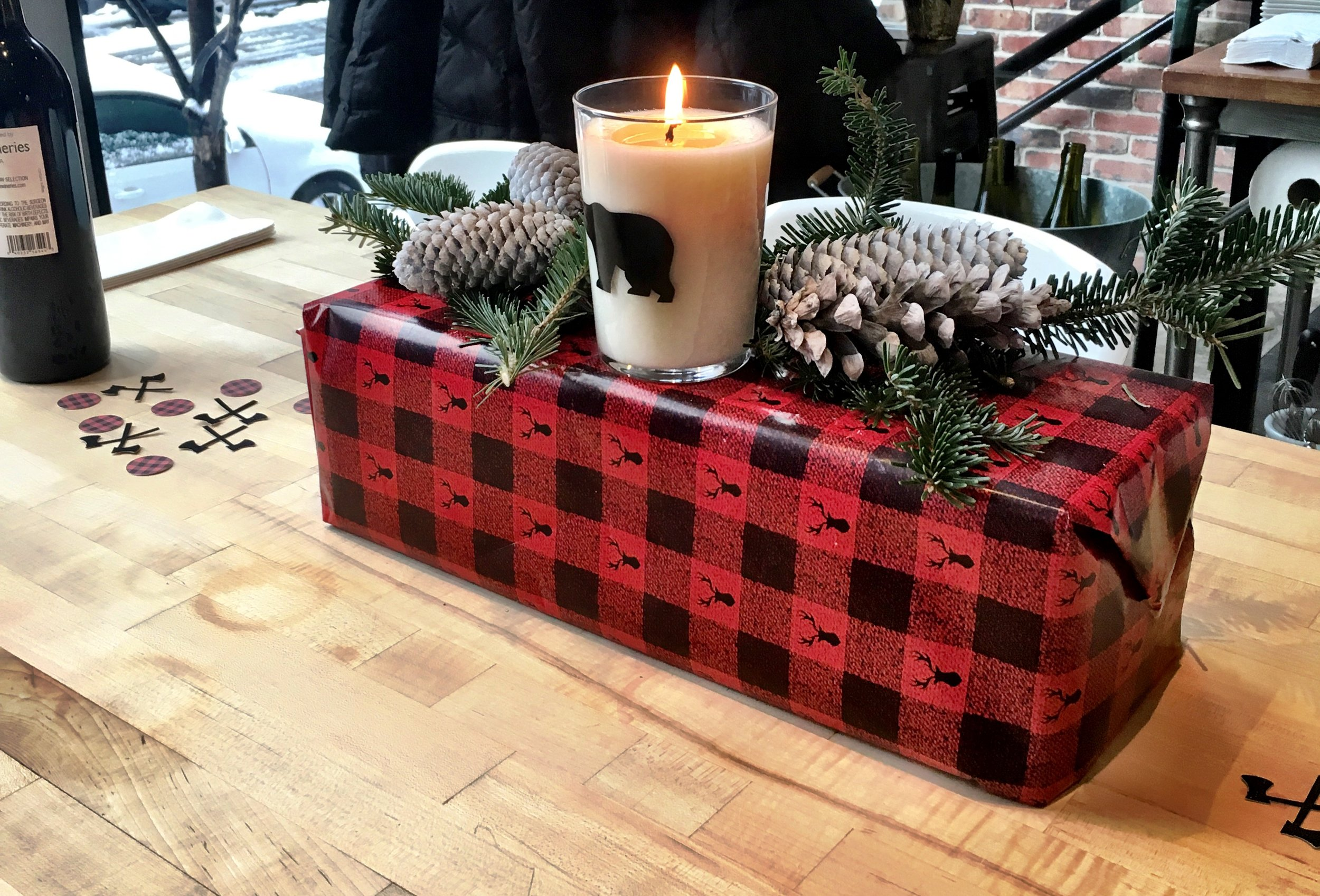 Woodsy Centerpieces - white sprayed pinecones, cuttings off my Christmas tree and buffalo plaid wrapped boxes
