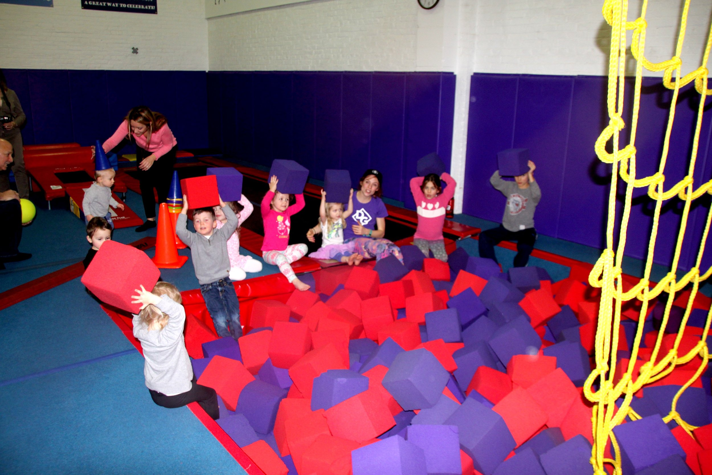 The kids having a blast in the ball pit