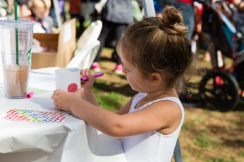 A child decorating her own donation jar at Full Circle