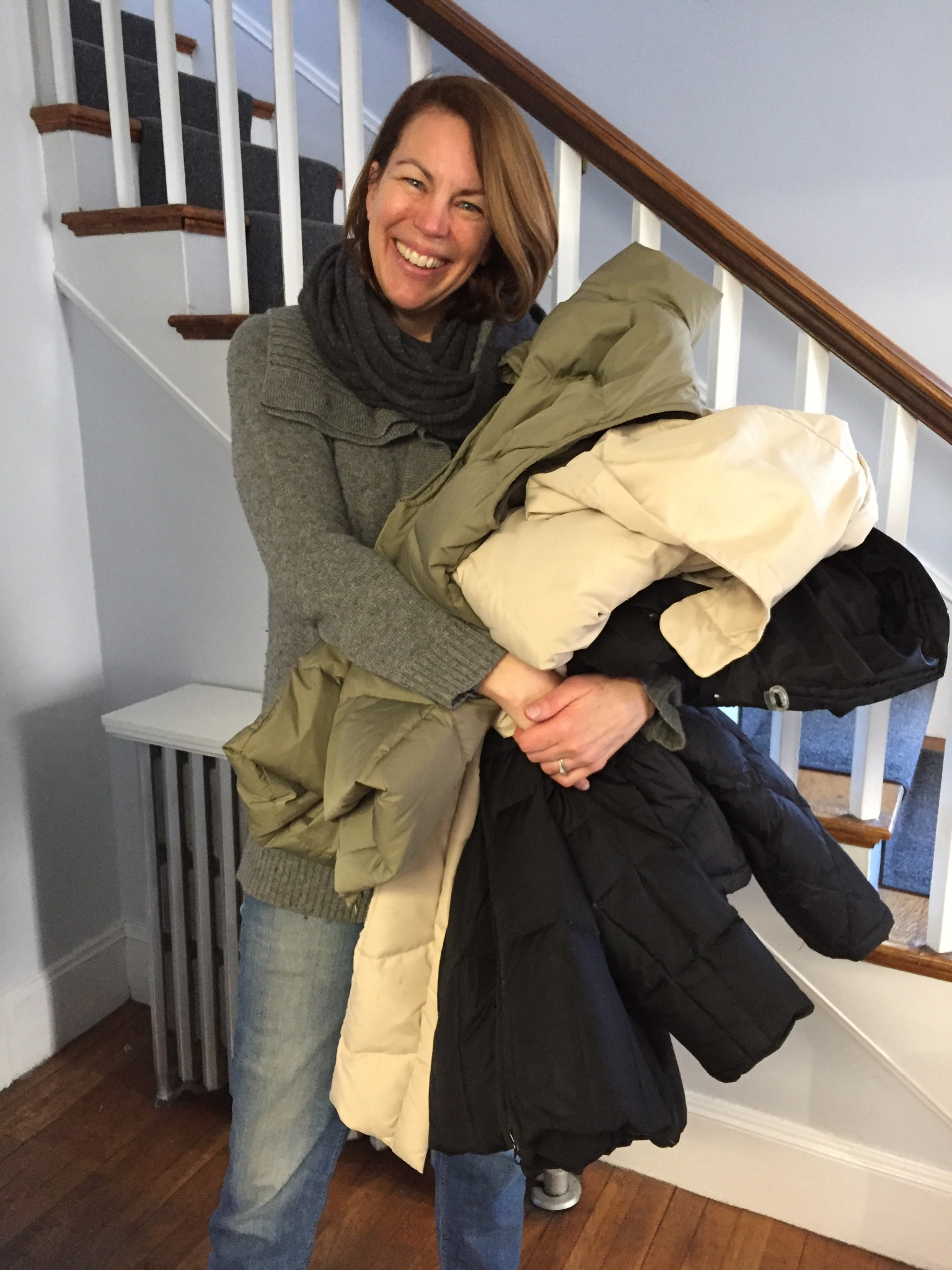Circle of Hope volunteer holding winter coat donations