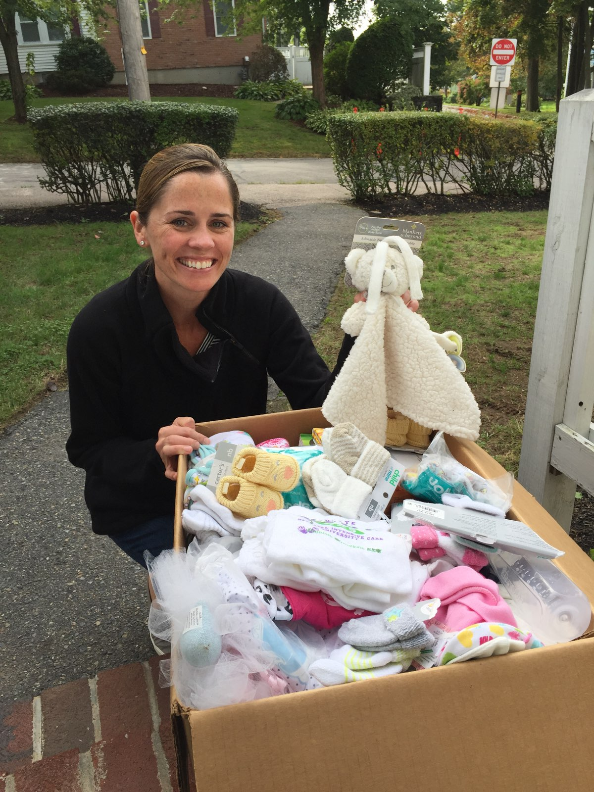 A woman donating new baby items to Circle of Hope