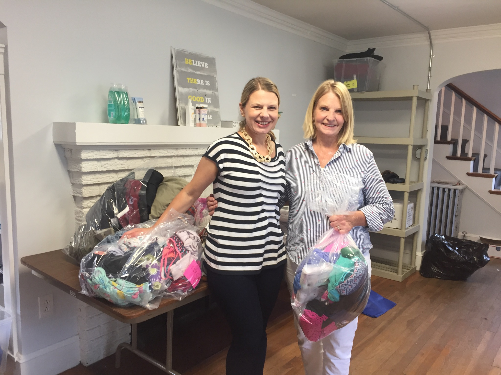 COH Board Member Sarah Hart and her mother, Sue, packaging clothing for two families who lost everything in a recent house fire