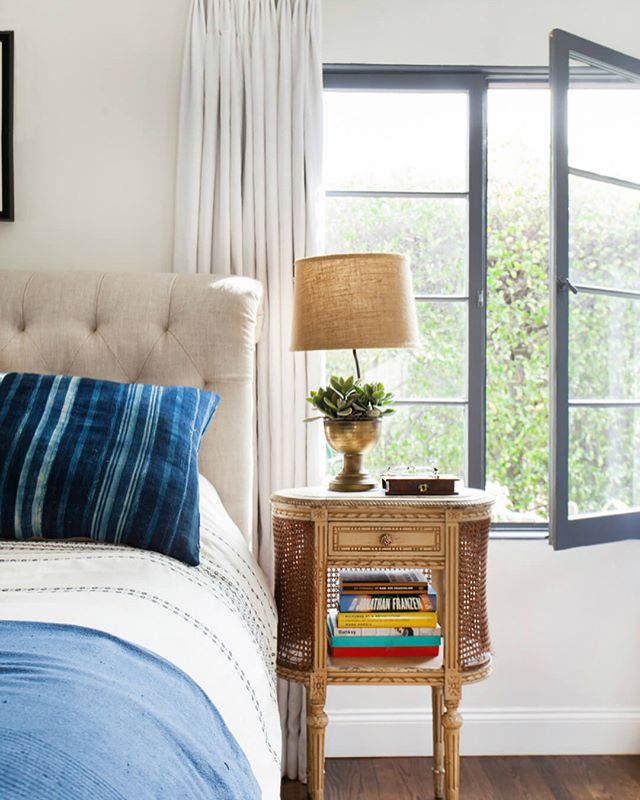 This bedroom by @em_henderson is such a beautiful mix of old and new, lived in, yet fresh. Our partners are packing for @highpointmarket antique and design center and we can't help but want to put all the vintage things in our projects after seeing their awesome goods get loaded up. While the shop looks in complete disarray from all the moving, it's all the hard work put in that leads to amazing finished projects and showrooms. Good luck @thesweetwoodcollection gals 😘😘😘