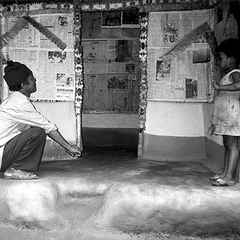 Decorating the huts together. We think that children born in the camps will help us in the future to return to our country. They do not know about Bhutan but we elder ones have to teach them about the Bhutanese situation. Bhimma  / PhotoVoice / LWF