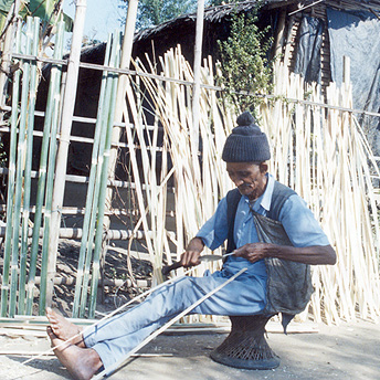 Preparing bamboo to fix a hut.  Dil / PhotoVoice / LWF