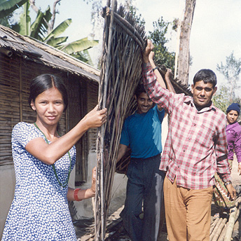 We are refugees so our homes are made of mud and plastic.  My brothers are repairing our house.  Though we are refugee we are satisfied and we make the house as nice as possible. Dilu / PhotoVoice / LWF