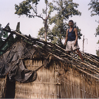 During the rainy season huts get damaged easily by the weather.  We have to do repairs often. Dhanapati  / PhotoVoice / LWF