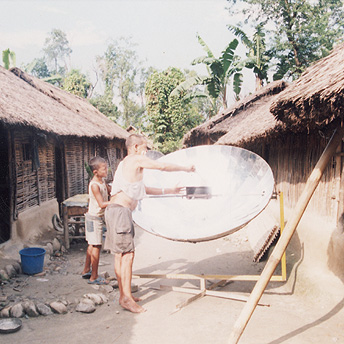Some refugees cook their daily meal in a solar oven. We have to do this because we are not given sufficient kerosene to cook all our meals.    Suresh / PhotoVoice / LWF