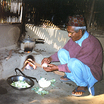 This old man cooks in his hut using firewood. We are given brickettes to use but they burn slowly and do not cook the food properly. We have to buy firewood or collect it ourselves and this is hard for some people.  Abishek / PhotoVoice / LWF