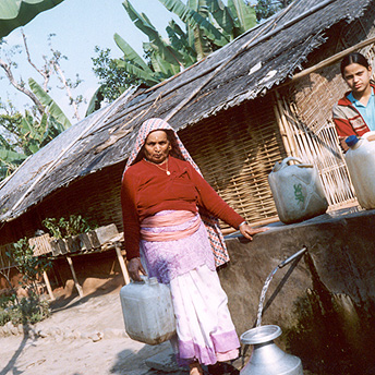 My mother carries the water back to our hut.    Prem / PhotoVoice / LWF
