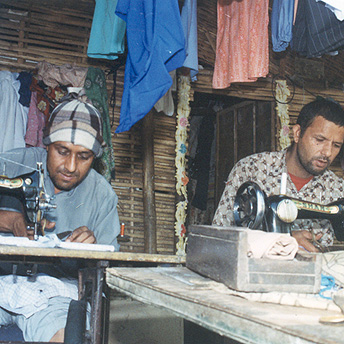 In camp there are people who sew our clothes. These people are important because without them we would have no clothes ready to wear. Due to scarcity of space in the huts he sits outside to sew the clothes. Aite Maya / PhotoVoice / LWF