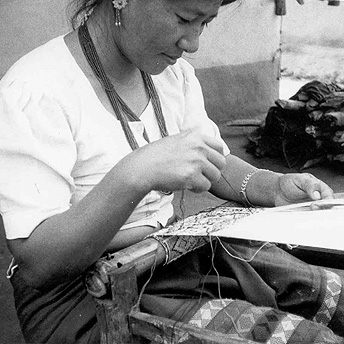 Refugee people have many skills. This woman is weaving a cap to earn extra money. With this income she will be able to buy extra vegetables. In the camp we don't have an income so we take a lot of trouble to earn money. Bishnu Maya / PhotoVoice / LWF