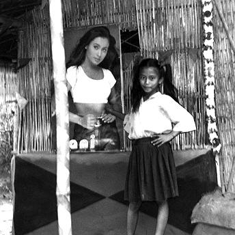 Girl outside hut. Nar Bdr / PhotoVoice / LWF