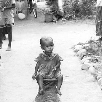 Girl on a stool     Mon Maya / PhotoVoice / LWF