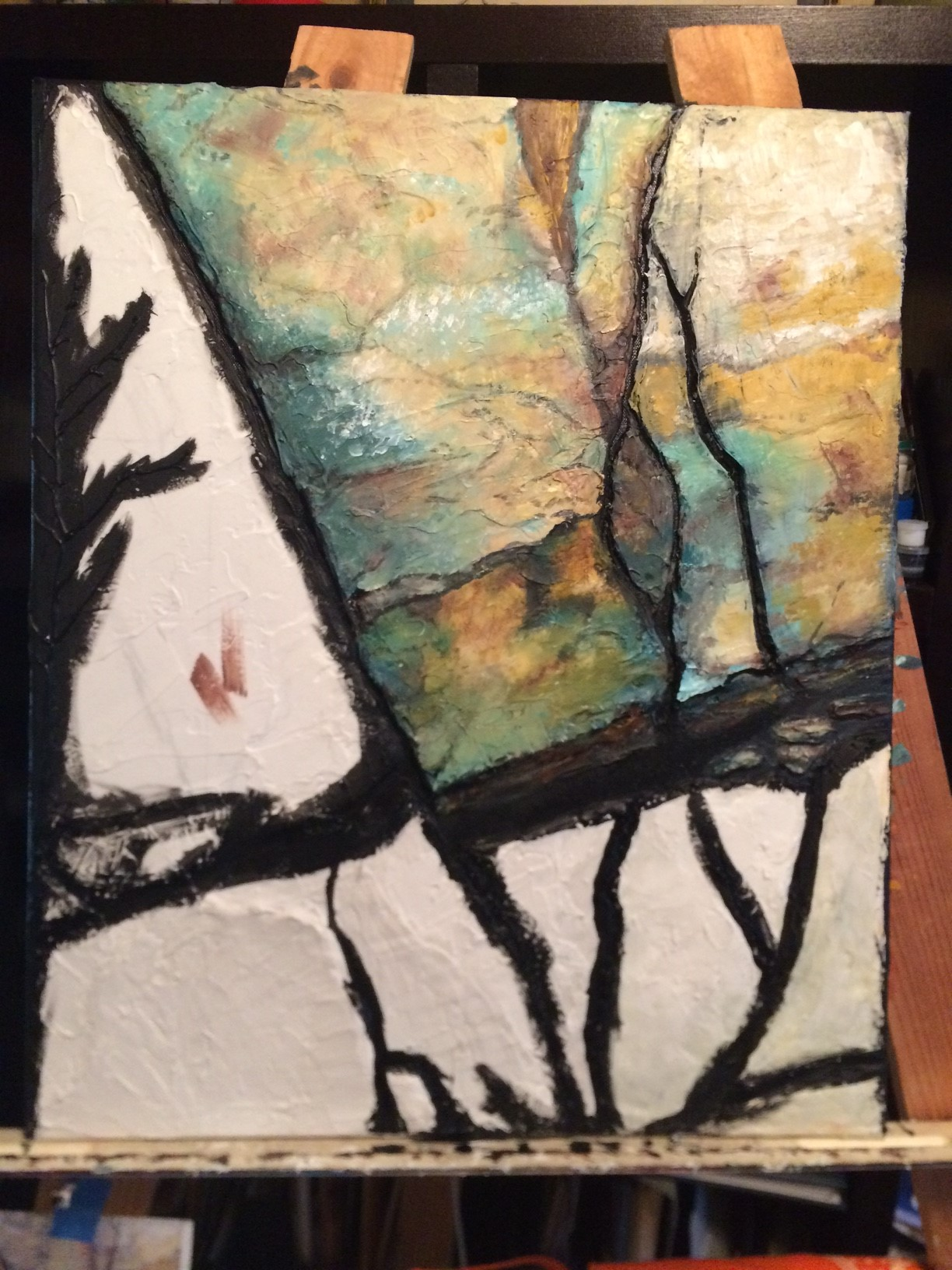 Apply modeling paste with a palette knife and begin painting